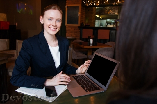 Devostock Beautiful Girl BUSINESSWOMAN Smiling Laptop