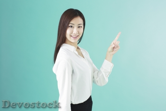 Devostock Beautiful Girl Pointing Hand Finger Smiling