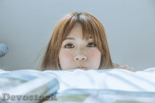 Devostock Beautiful Japanese woman TAIWANESE LADY INFLATING CHEEKS