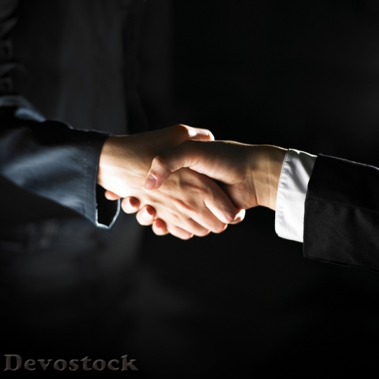 Devostock BUSINESSMEN SHAKING HANDS