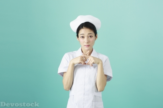 Devostock FEMALE NURSE Crossed FINGERS Sad