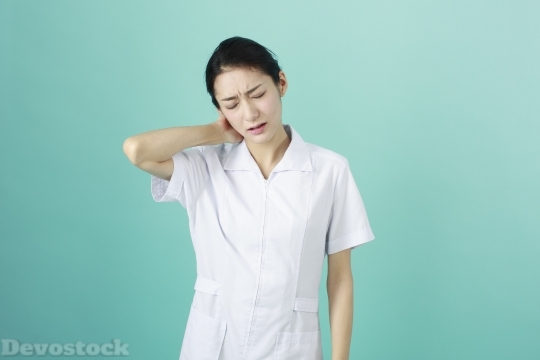 Devostock FEMALE NURSE SUFFERING NECK PAIN