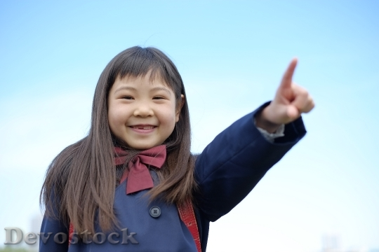 Devostock GIRL POINTING ELEMENTARY SCHOOL STUDENT