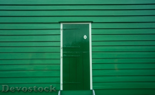 Devostock Green Door Wood Entrance 6336 4K.jpeg