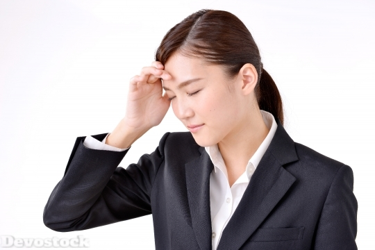 Devostock HEADACHE BUSINESS WOMAN