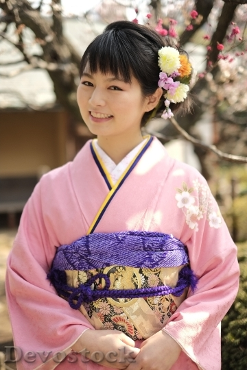 Devostock JAPANESE Girl Traditional Dress KIMONOS Smiling