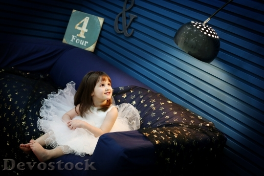 Devostock Little Girl Angel Indoor Room 4K.jpeg