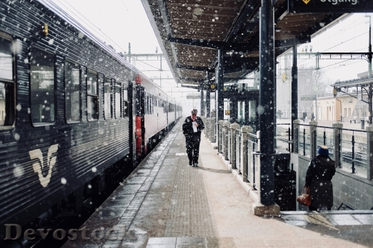 Devostock PLATFORM STATION TRAIN SNOWING