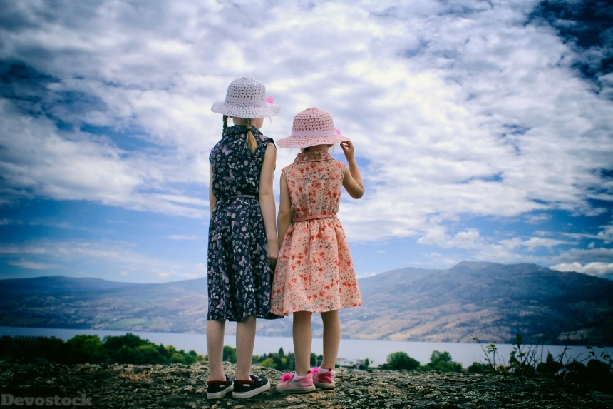 Devostock Back View Two Sisters Looking Outdoor Sky Love Family Concept 4k