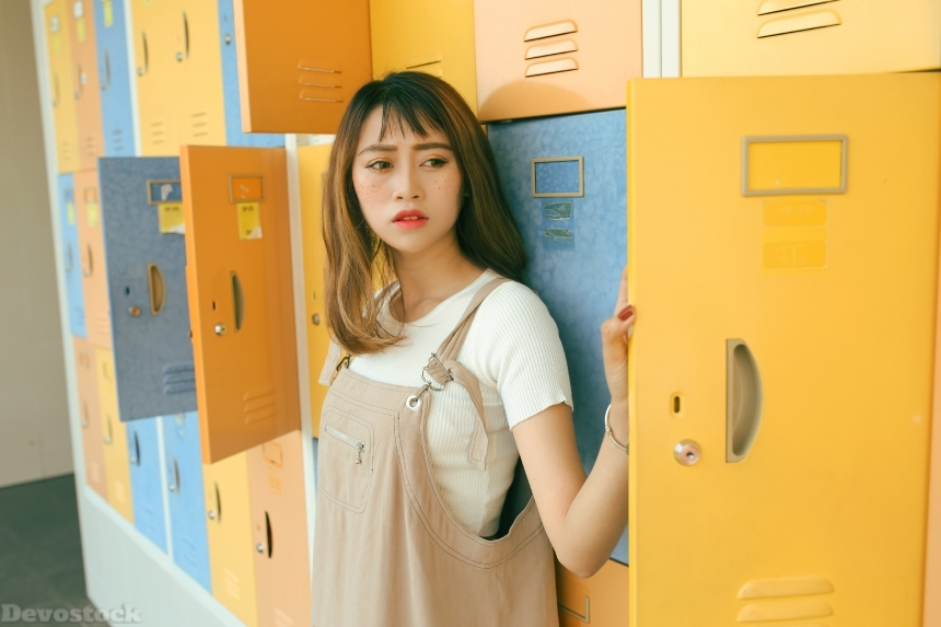 Devostock Beautiful Asian Girl Standing Lockers Thinking 4k