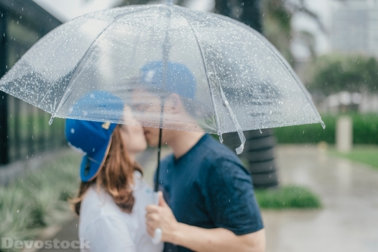 Devostock Couples Kissing Umbrella Raining Love 4k