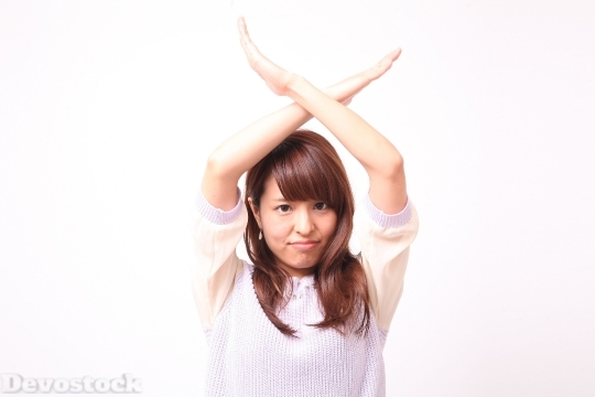 Devostock Girl Body Language Hand Sign No 4k