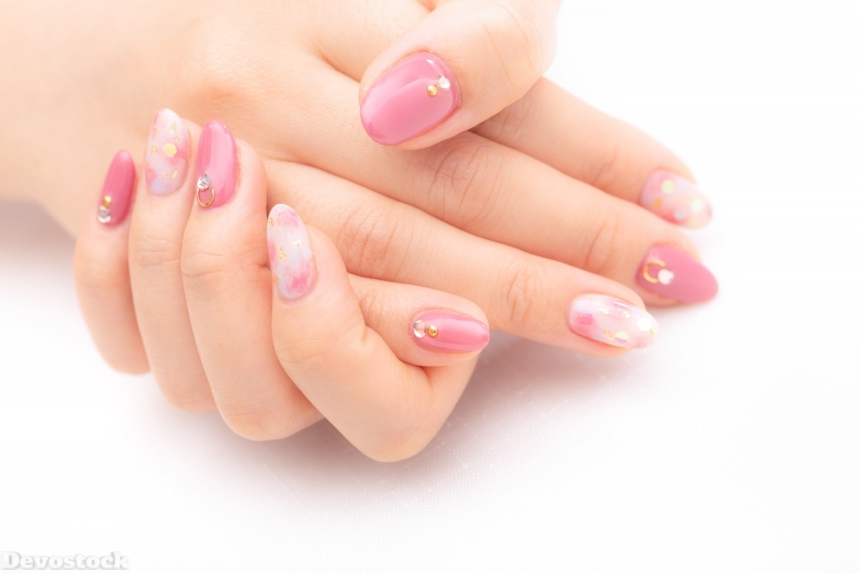 Devostock Girl hands Fingers Nail Arts Pink Color Holding 4k