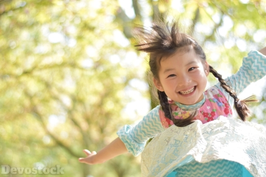 Devostock Jumping Happy Little Girl Nature 4k