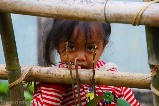 Devostock Laos Girl Child Staring 4K