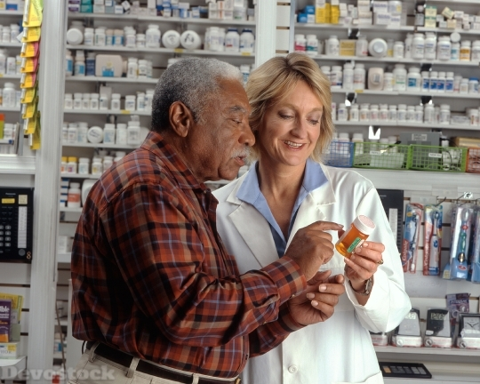 Devostock Man Consults With Pharmacist 4K
