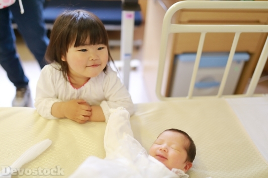 Devostock Newborn Baby Sister Happy 4k