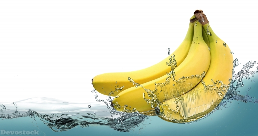 Devostock Ripe bananas on a background of splashing water.