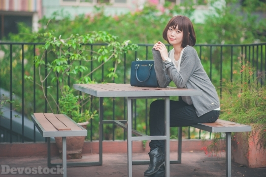Devostock Taiwanese Lady Sitting Desk Daytime Girl 4k