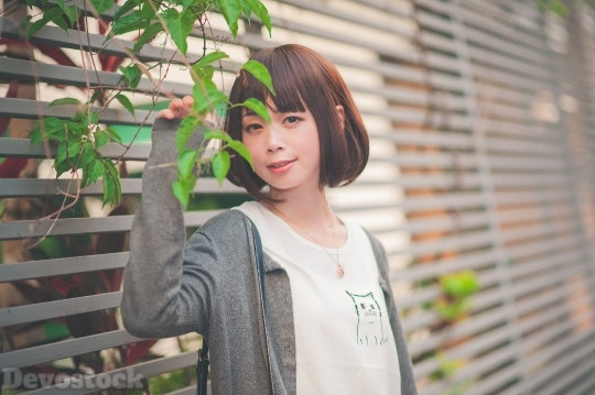 Devostock Taiwanese Lady Standing Tree Girl 4k