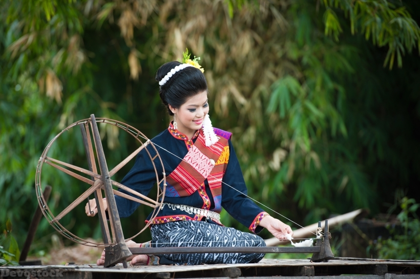 Devostock Thai Woman Spinning Wheel Traditional Dress String 4k