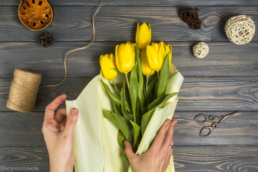 Devostock Tulips Yellow Hands Wood planks Flowers 4k