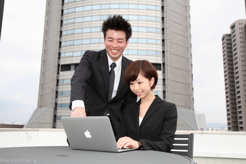 Devostock Woman Man Laptop Showing Employment Interview Business Office 4k