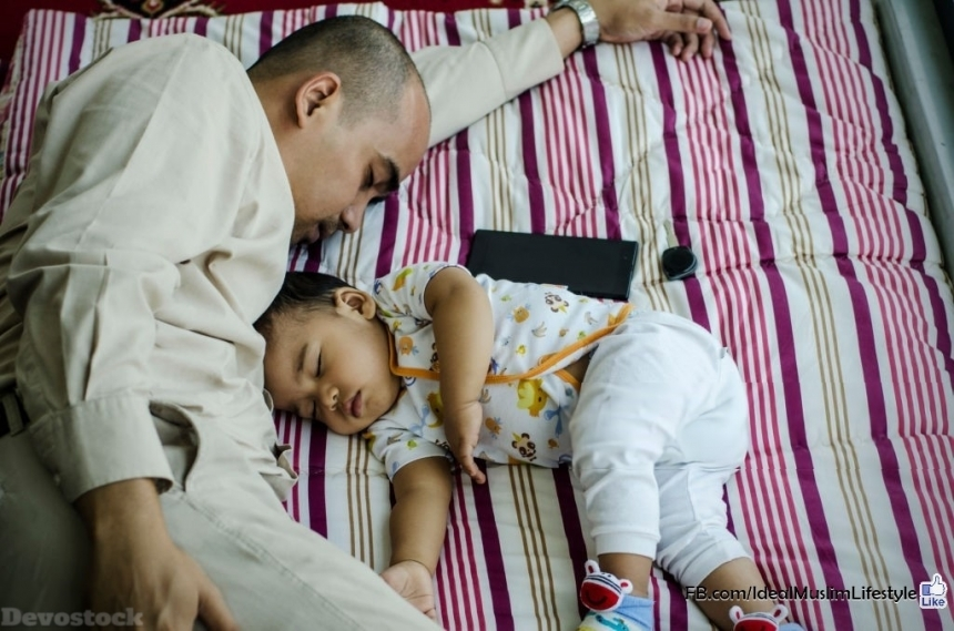 Devostock A  Muslim father sleeping with his son