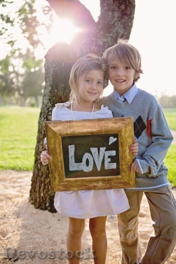 Devostock A boy and a girl holding love sign