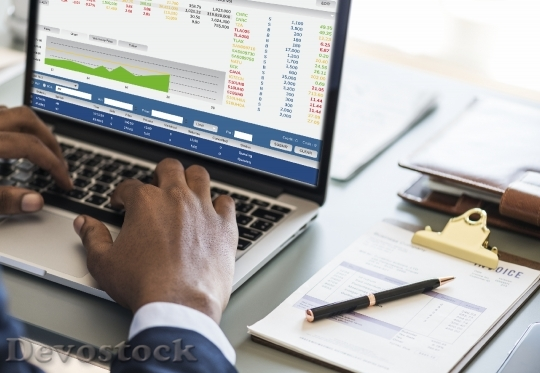 Devostock Black businessman using computer laptop