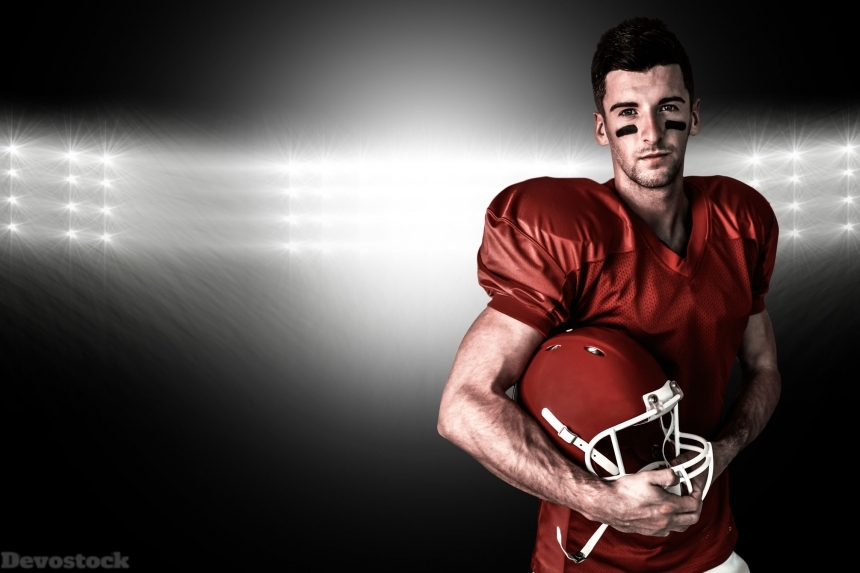 Devostock Composite image of portrait of rugby player posing with helmet