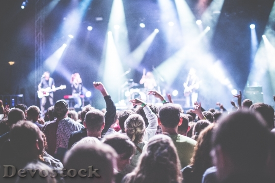 Concert with people around dancing