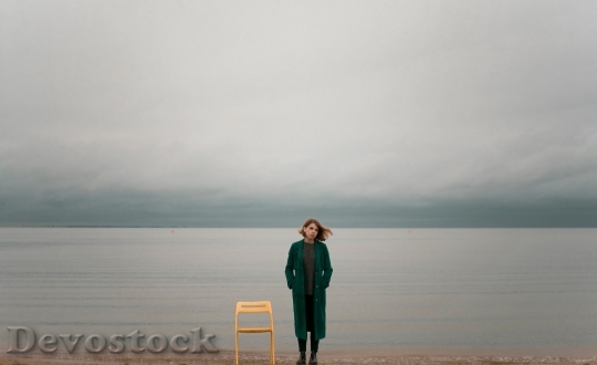 Devostock Girl Alone Beach Cloudy