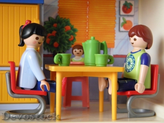 Devostock Lego boy and girl at the table