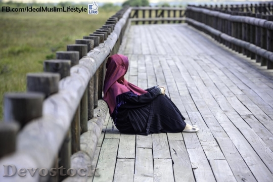 Devostock Muslim woman looking