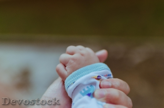 Devostock Baby Hands Family People