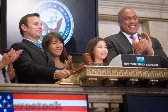 Devostock Medal of Honor recipient Senior Chief Special Warfare Operator (SEAL) Edward C. Byers, Jr., first from left, prepares to close the New York Stock Exchange.